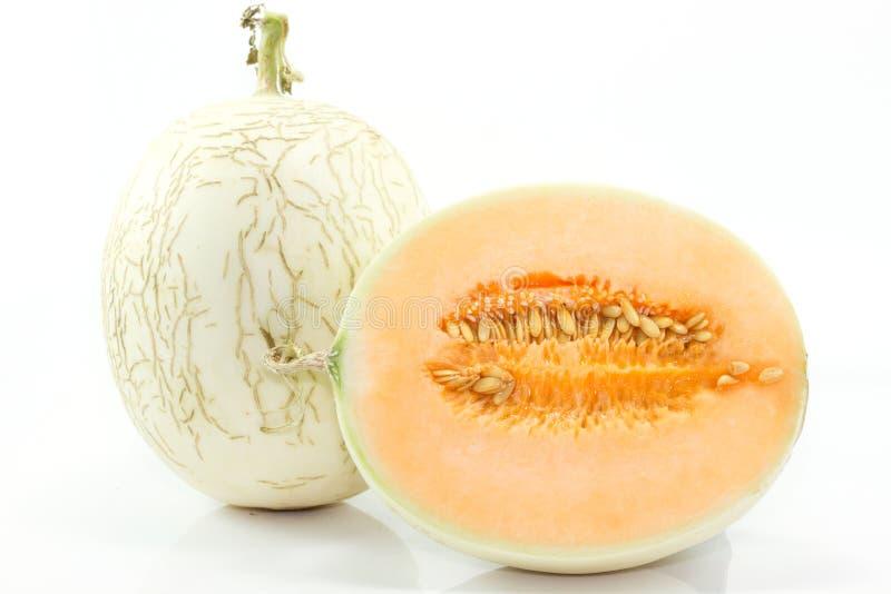 Cantaloupe on white background. Cantaloupe (also cantelope, cantaloup, muskmelon (India and the United States), mushmelon, rockmelon, sweet melon, honeydew royalty free stock photo