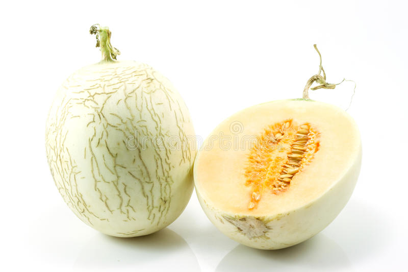 Cantaloupe on white background. Cantaloupe (also cantelope, cantaloup, muskmelon (India and the United States), mushmelon, rockmelon, sweet melon, honeydew royalty free stock photography