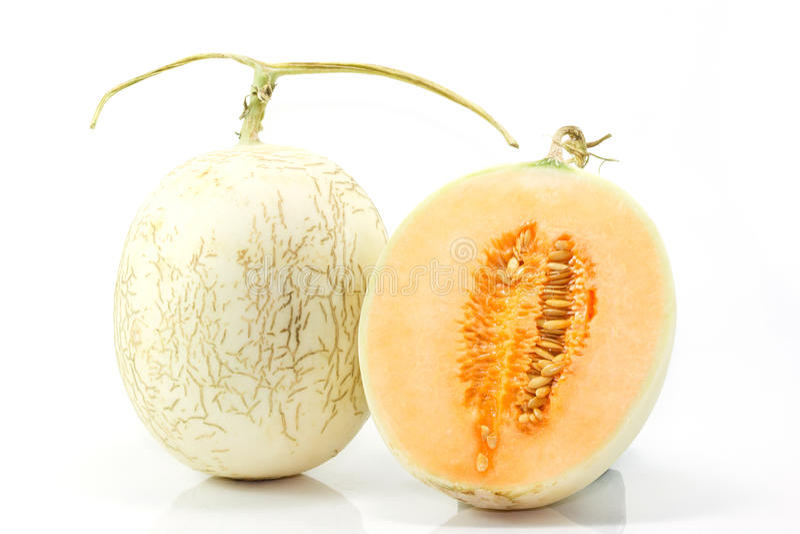 Cantaloupe on white background. Cantaloupe (also cantelope, cantaloup, muskmelon (India and the United States), mushmelon, rockmelon, sweet melon, honeydew royalty free stock photos