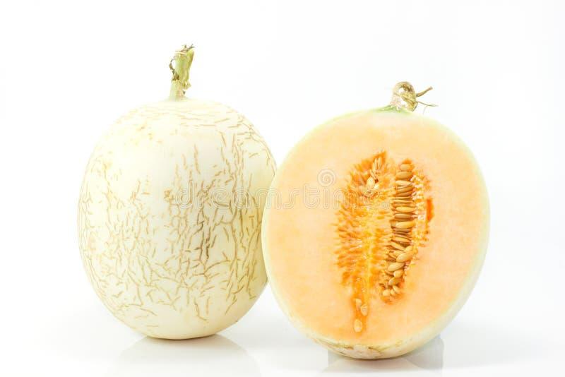 Cantaloupe on white background. Cantaloupe (also cantelope, cantaloup, muskmelon (India and the United States), mushmelon, rockmelon, sweet melon, honeydew stock photo