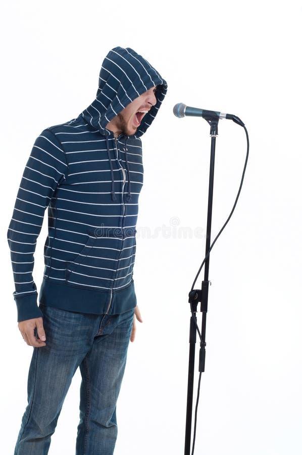 Cantante di roccia con il microfono immagine stock libera da diritti