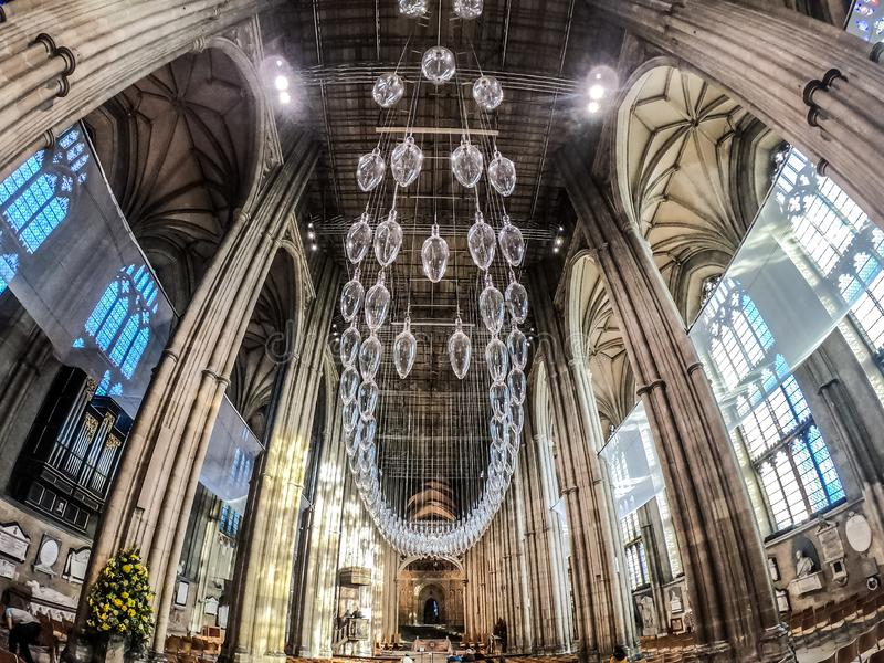 CANTERBURY, ENGLAND 8 NOV, 2018: Interior of Canterbury cathedral. Central glass chandelier royalty free stock images