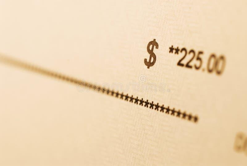 Cantidad del control de la paga en el papel imagenes de archivo