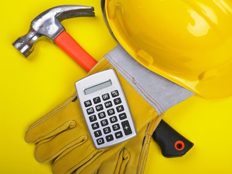 Cantiere - calcolatore dei guanti del martello dell'elmetto protettivo fotografia stock