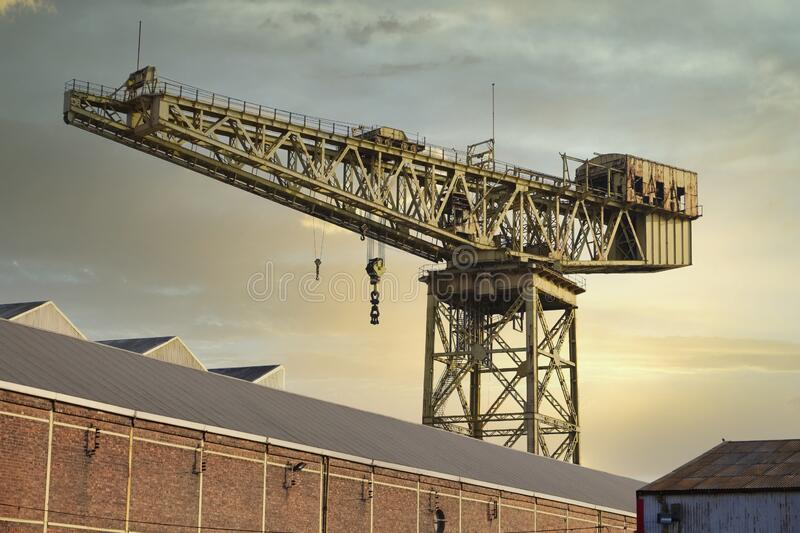 Cantilever lifting crane for shipbuilding in Govan near Glasgow and freight container transportation. Uk royalty free stock image