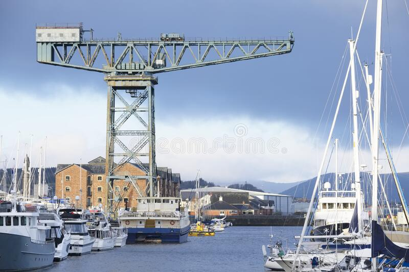 Cantilever lifting vintage crane for shipbuilding in Greenock near Glasgow and freight container transportation. Uk royalty free stock photography