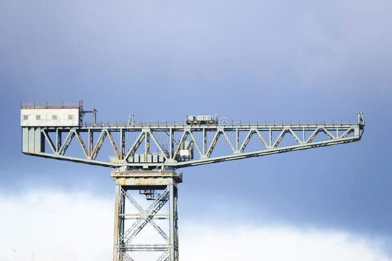 Cantilever lifting vintage crane for shipbuilding in Greenock near Glasgow and freight container transportation. Uk royalty free stock image