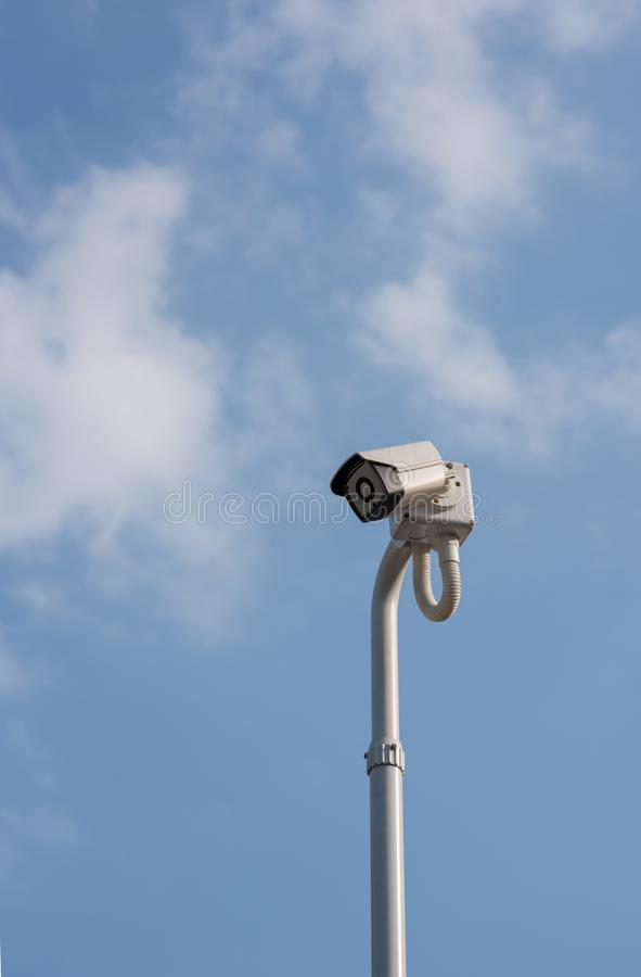 A cantilevered modern white security CCTV camera. stock photography