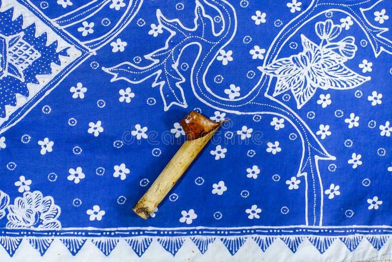 Canting and Batik. Canting batik tulis with blue fabric royalty free stock photography
