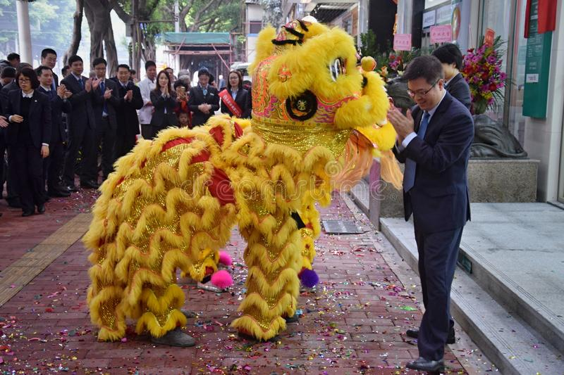 CANTON, CHINA – CIRCA FEBRUARY 2019: Group of martial art artists give a performance of Lion Dance. Group of martial art artists give a performance of stock photography