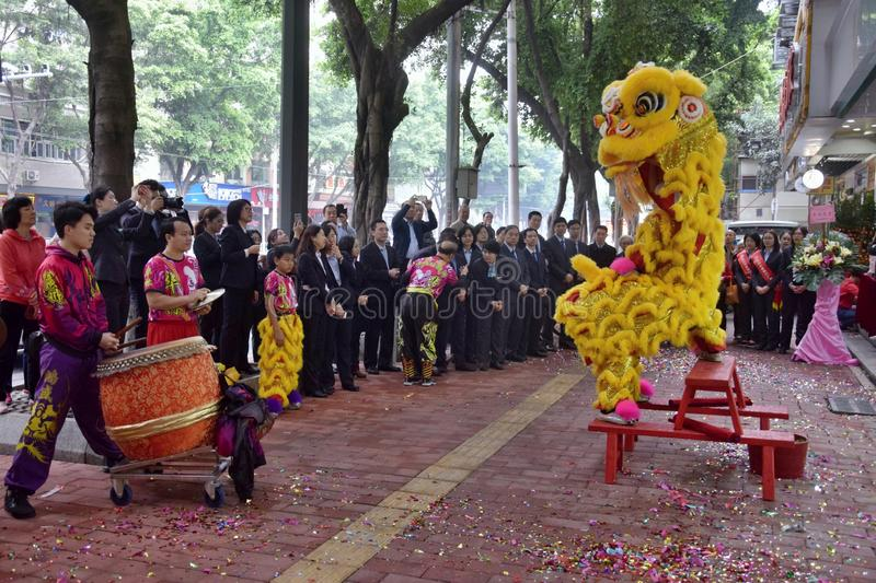 CANTON, CHINA – CIRCA FEBRUARY 2019: Group of martial art artists give a performance of Lion Dance. Group of martial art artists give a performance of stock image
