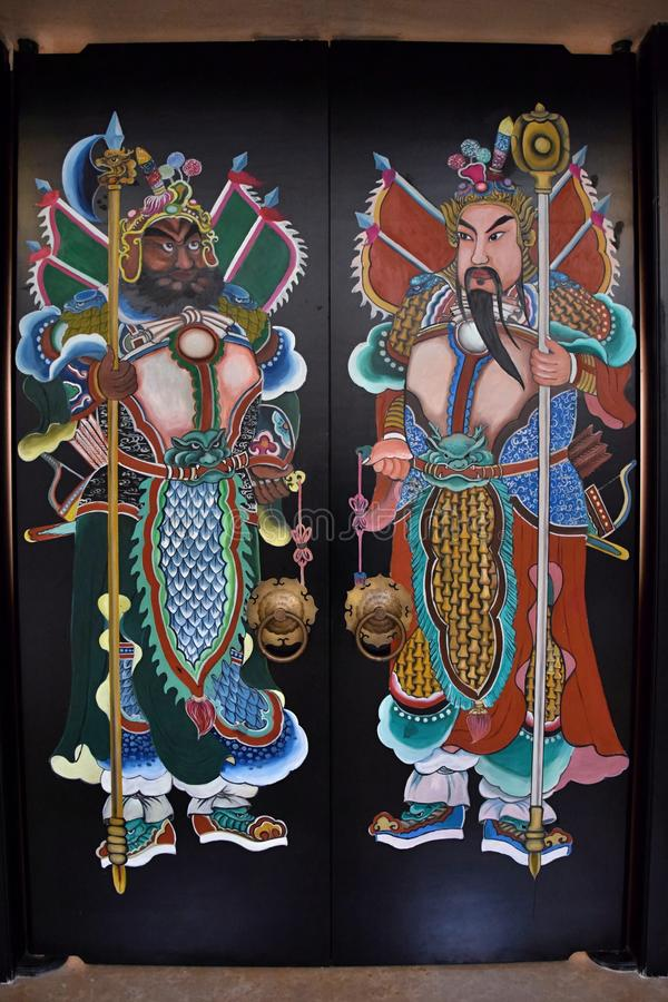 CANTON, CHINE, VERS EN DÉCEMBRE 2016 : La peinture des dieux de porte dans la religion folklorique chinoise image libre de droits