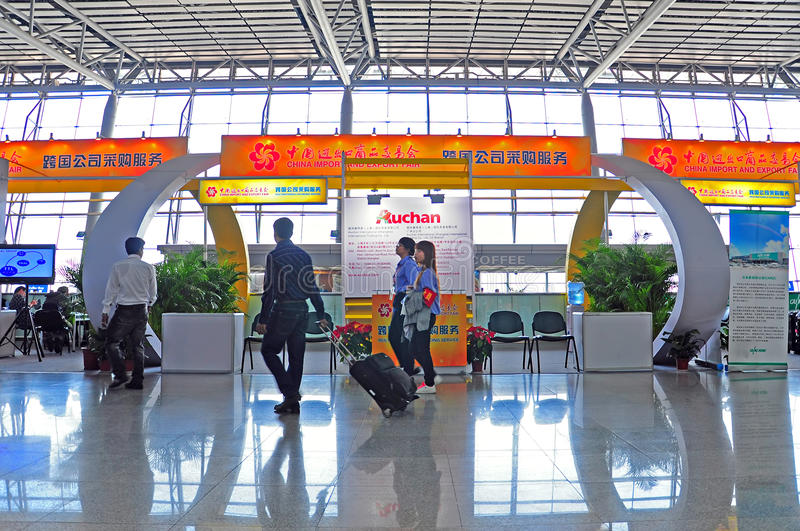 Canton fair china help desks. Visitors moving along help desks at canto fair china royalty free stock image