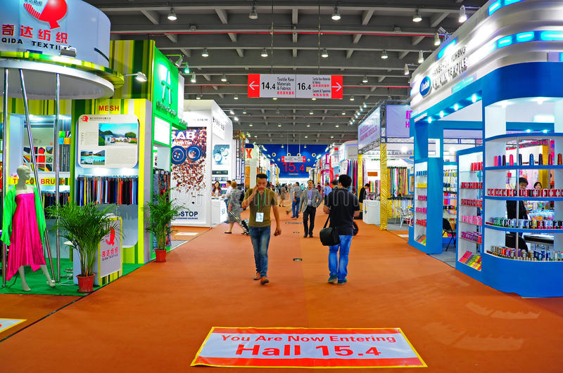 Canton fair pavillions 2013. Activities of visitors and buyers at the hall 15.4 of canton fair 2013 where the office garments and textile raw material items were royalty free stock images