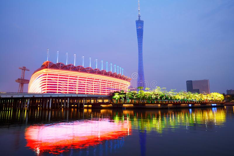 Canton Tower and Stadium. Reflecting in Zhujiang River, colorful night lights, Guangzhou, China royalty free stock image