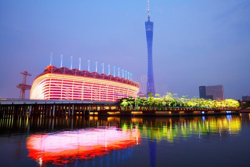 Canton Tower and Stadium. Reflecting in Zhujiang River, colorful night lights, Guangzhou, China