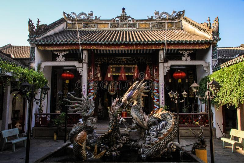 At the back of the The Cantonese Assembly Hall, showing the dragon fountain, hoi an, Quang Nam Province, Vietnam royalty free stock image