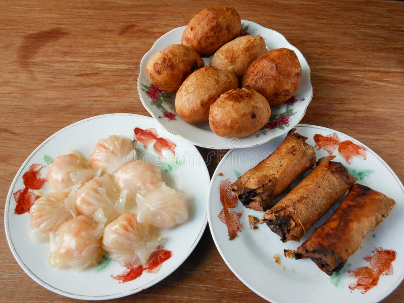 Cantonese assorted dim sum Har gow, Haam Seoi Gaau and Spring roll. In restaurant for eating royalty free stock photography