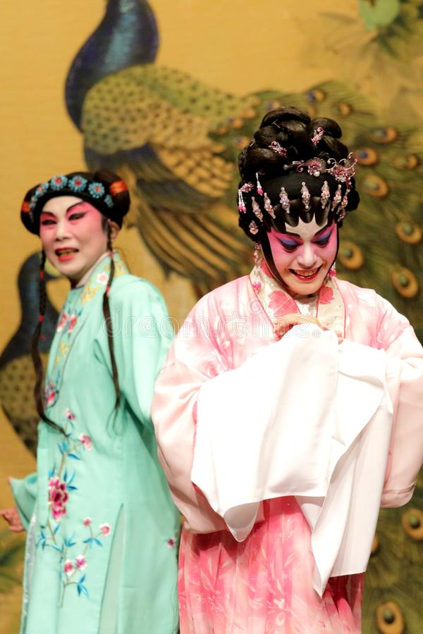 Cantonese Opera artists with colourful makeup and complicated costumes. Cantonese Opera artists perform in full Cantonese Opera costume - white and red face