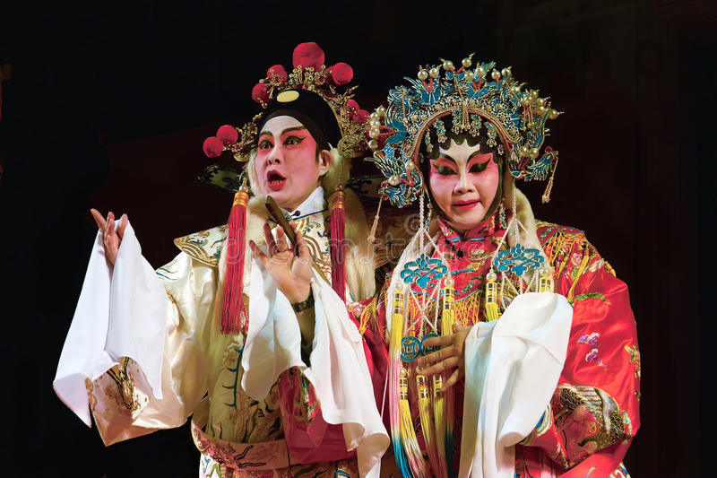 Cantonese opera excerpt. Chinese Opera in the black background stock photography