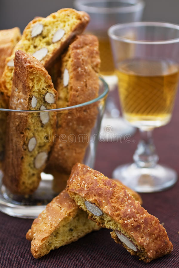 Cantucci closeup. Italian cantucci and two glasses of wine stock photography