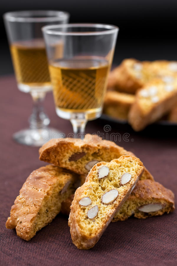 Cantucci e vin santo. Italian cantucci and two glasses of wine royalty free stock photo
