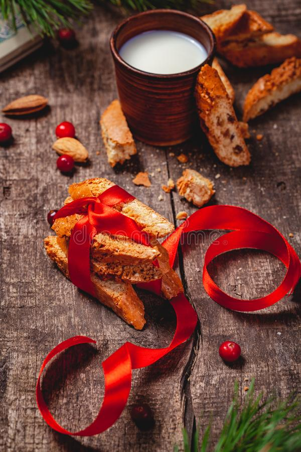 Cantucci with milk on wooden rustic table. Close up. Christmas or New Year food concept royalty free stock images