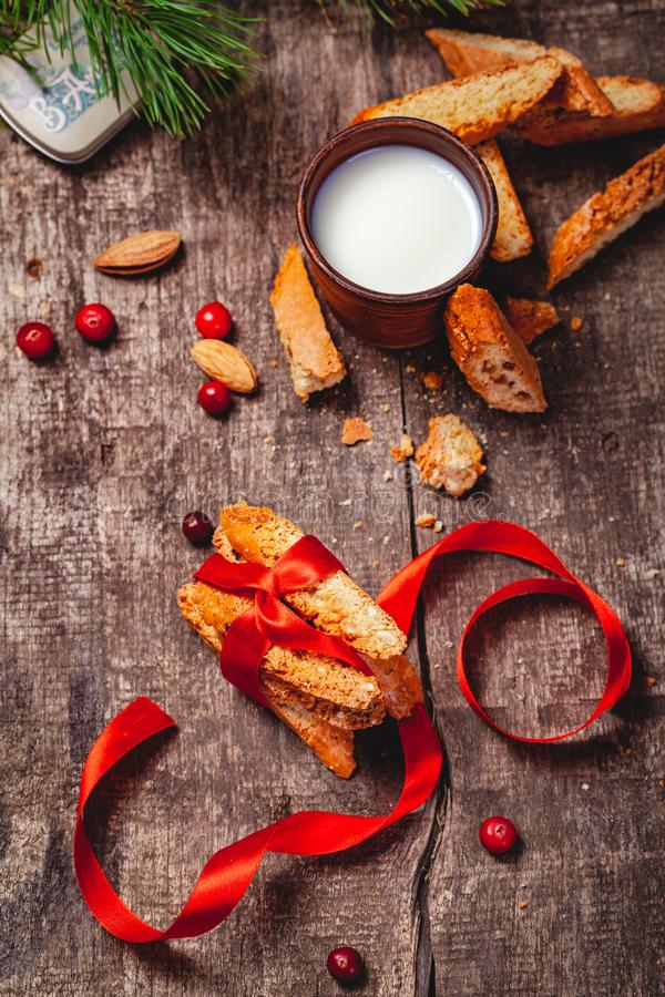 Cantucci with milk on wooden rustic table. Close up. Christmas or New Year food concept. Cantucci with milk on wooden rustic table. Close up. Top view. Christmas stock photos