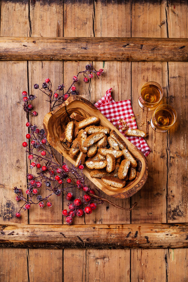 Cantucci in olive wood bowl. On wooden background stock photo