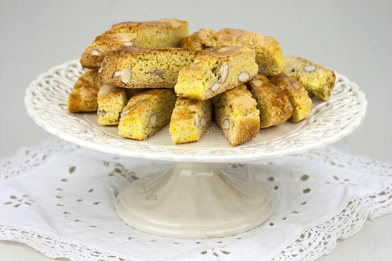 Cantucci. A tipical tuscan biscuits on a white cake stand royalty free stock images