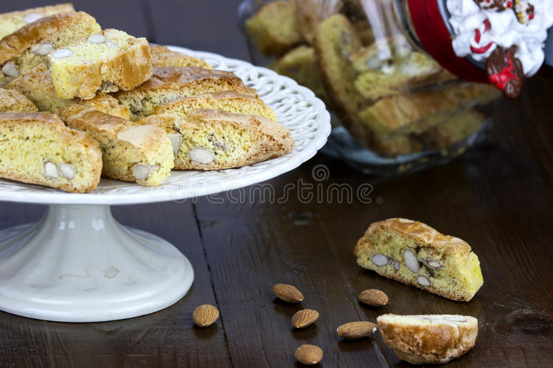 Cantucci. A tipical tuscan biscuits on a wooden brown table stock photo