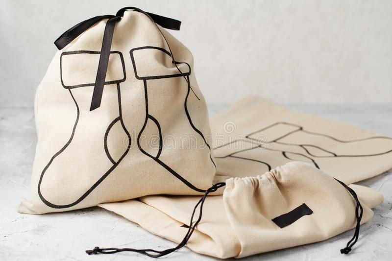 Canvas bag with drawstring, mockup of small eco sack made from natural cotton fabric stock image