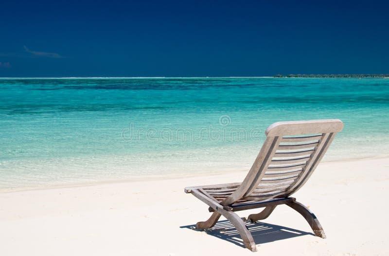 Canvas chair on tropical beach stock photography