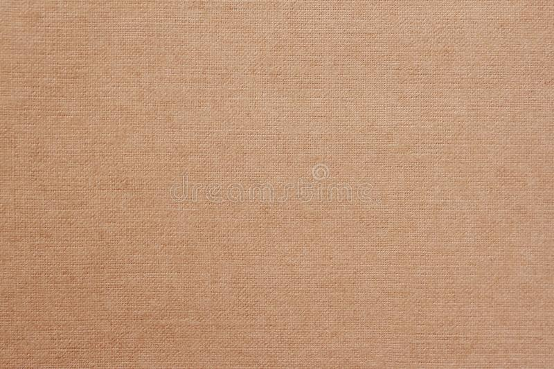 Canvas, fabric background with visible texture, print design elements. Closeup of warm, soft coffee color jute, texture stock photography
