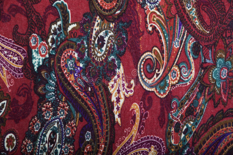 Canvas fabric with multicolored floral paisley pattern. Canvas fabric with multicolored bright floral paisley pattern in red and blue colors stock photography