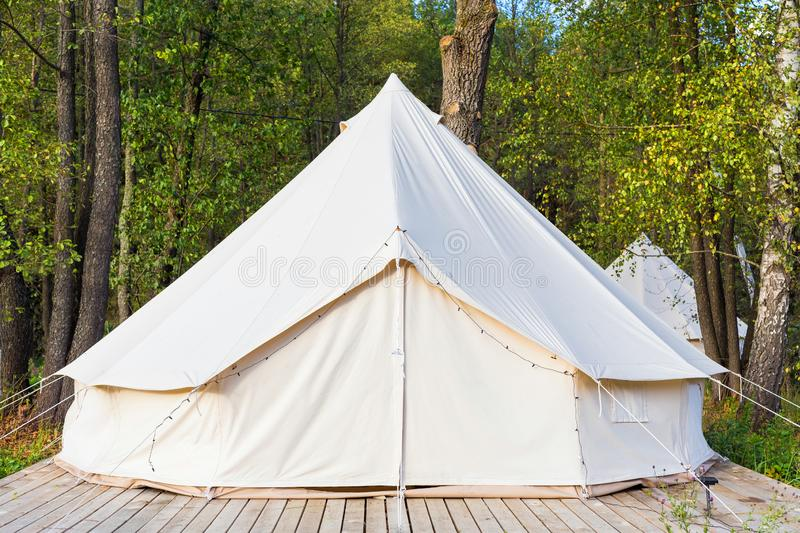 Canvas glamping tent at forest. Canvas glamping bell tent at forest royalty free stock photo