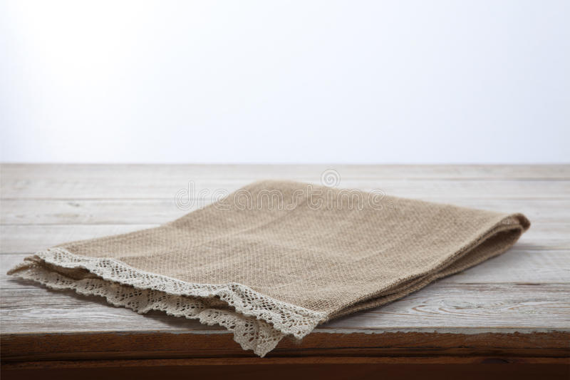 Canvas napkin with lace. Burlap hessian sacking on white wooden table background top view. Burlap hessian sacking on white wooden table top view stock photos