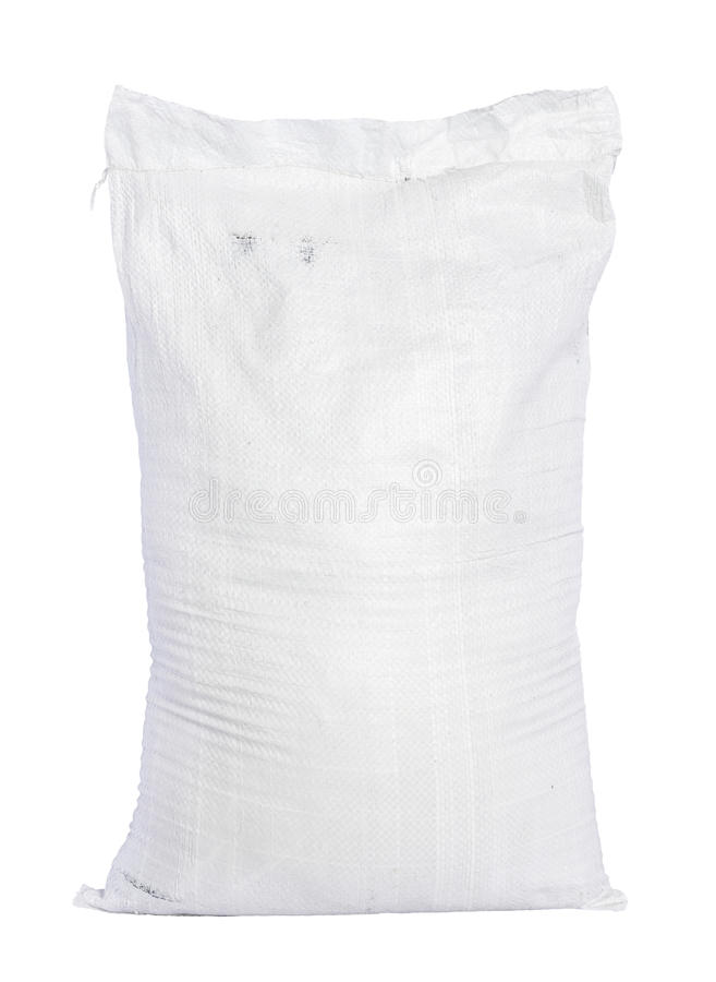 Canvas sack with full fertilizer. White canvas sack with full fertilizer isolated on white background royalty free stock images