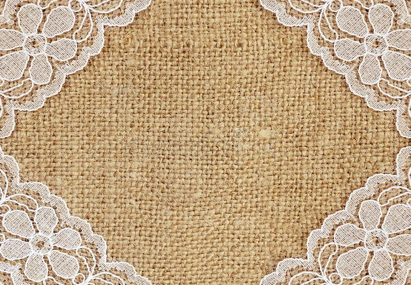 Canvas with white laceas a frame. Canvas background with white lace as a frame. Flat lay royalty free stock images