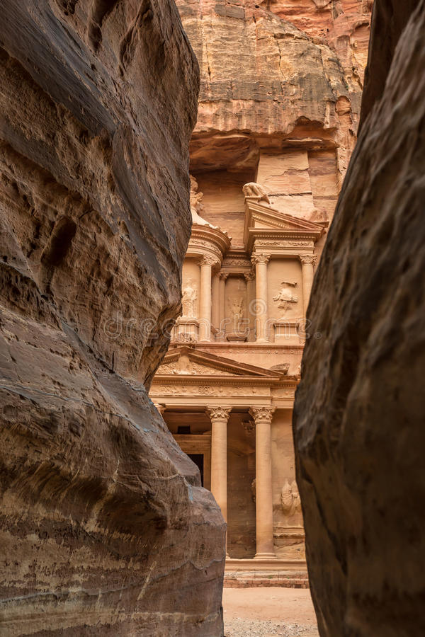 Canyon in the ancient city of Petra (Jordan) - opening view of the famous Al-Khazneh (aka Treasury). Hiking through the canyon in the ancient city of Petra ( royalty free stock images