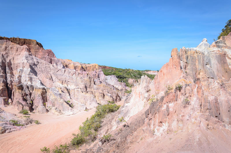 Canyon cliffs with many rocks sedimented by time, rocks with red and yellow colors. Cliffs of Coqueirinho beach, PB - Brazil stock photography