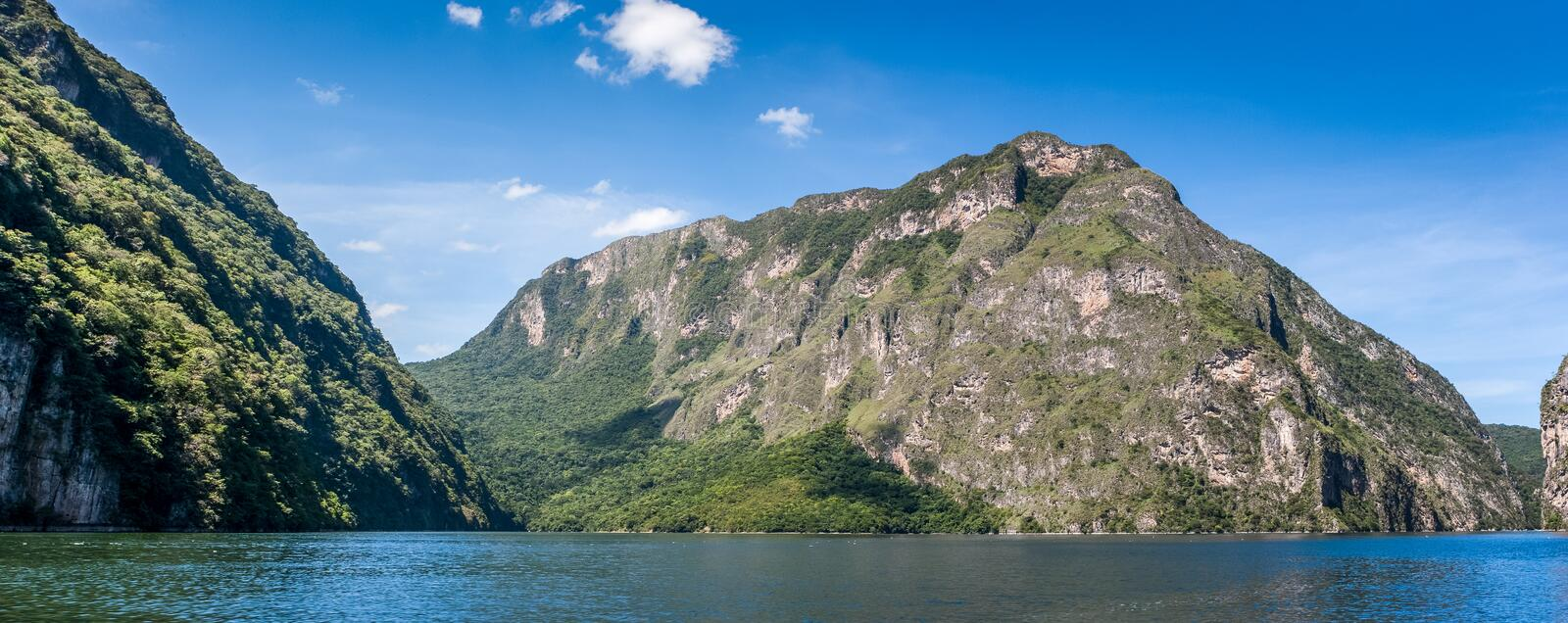 Canyon del Sumidero with blue sky, Chiapas, Mexico. Panoramic view of the Canyon del Sumidero, Chiapas, Mexico stock photo