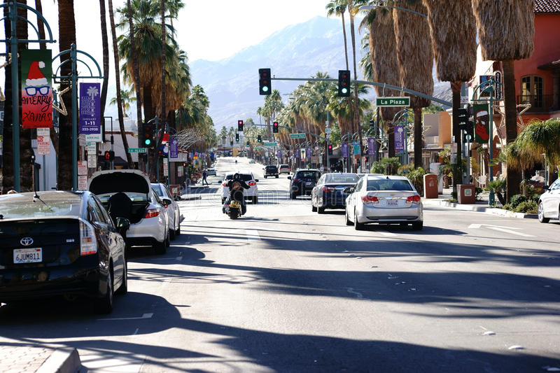 Canyon Drive Palm Springs. Palm Springs, United States - December 24, 2015: Road traffic with cars and a motorcycle at a traffic light intersection of Commercial stock photo