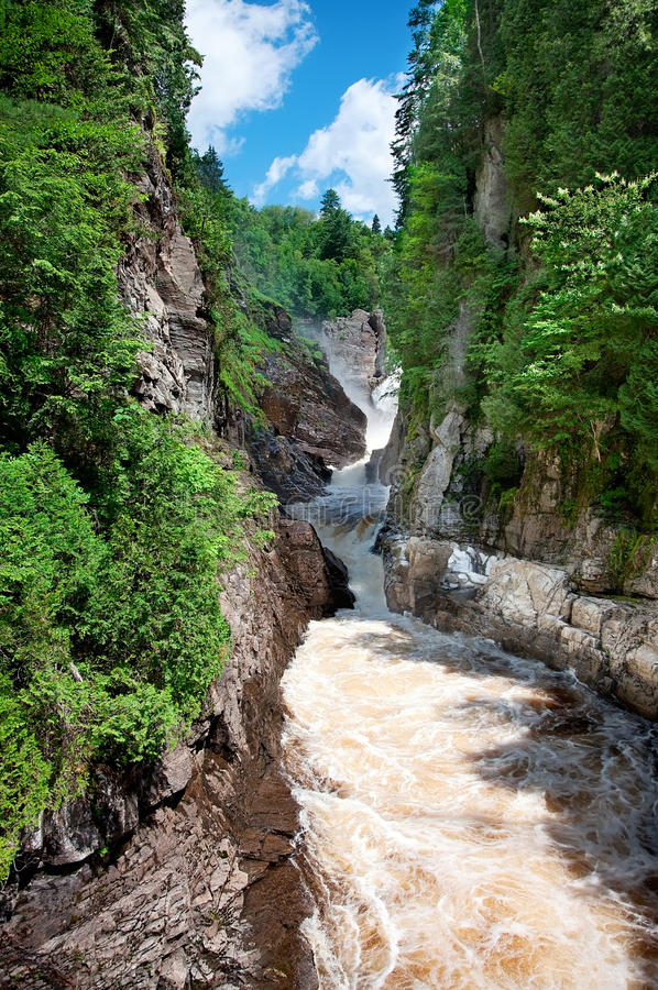 Canyon Ste-Anne, Quebec, Canada. Canyon Sainte-Anne in St-Joachim, Quebec, Canada near Ste-Anne de Beaupre. A 74 meter high waterfall is rumbling into a small stock photo