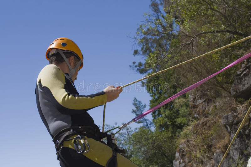 Canyoning men hold the rope. Adventure men hold the rope for your safety stock photo