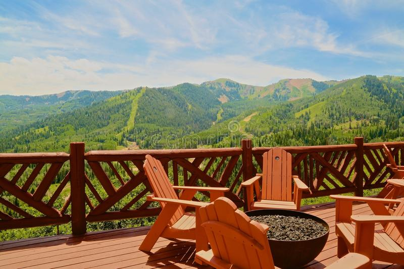 Canyons Mountain ski resort Park City Utah. Adirondack chairs and fire pit overlooking the Canyons Mountain ski Resort in Park City Utah royalty free stock photography