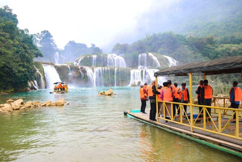 Cao bang, Vietnam - Nov 30, 2018 : Tourist visiting Ban Gioc Waterfall or Detian Falls Bamboo boat stock photos