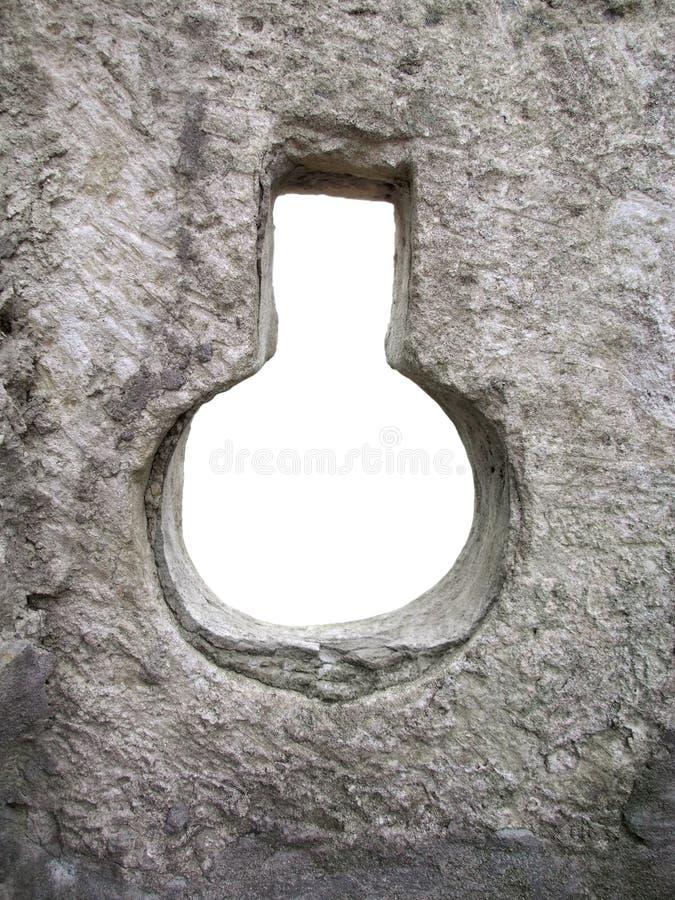 Capítulo - agujero en una pared de piedra imagen de archivo