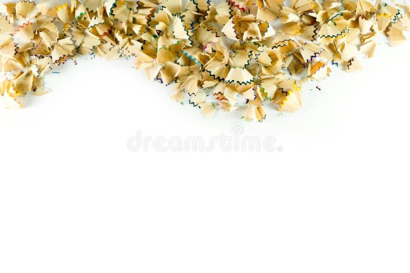 Capítulo hecho de virutas del lápiz del color en un Libro Blanco foto de archivo