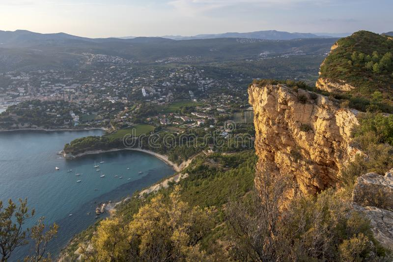 Cap Canaille cliffs overlooking Gulf of Cassis at Mediterranean Sea coast of French riviera at sunset light. Cap Canaille golden yellow cliffs overlooking Gulf stock photo